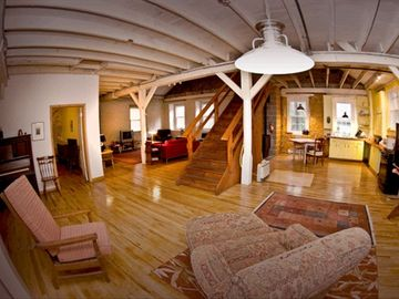 Large open loft space with living area and kitchen