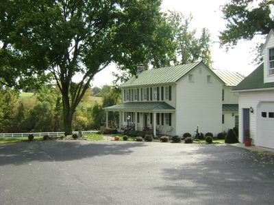 Farmhouse, garages and parking.