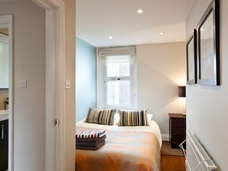 Islington apartment photo - Bedroom double bed, wardrobe, window, touch-lampshades, nicely dressed for you