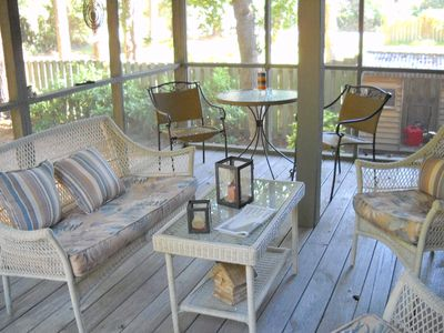 Screened porch offers a great place have morning coffee or evening cocktails