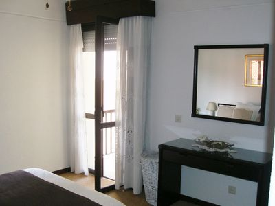 Main b/room with french door to small balcony