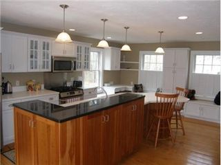 East Sandwich house photo - Kitchen with Island & Wood floors
