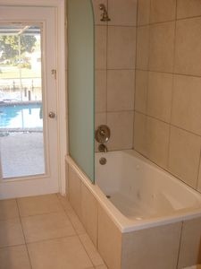 Main bath features jacuzzi tub/shower combination.