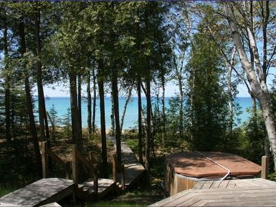 Hot tub off deck is beloved and wooden walkway provides easy access to beach