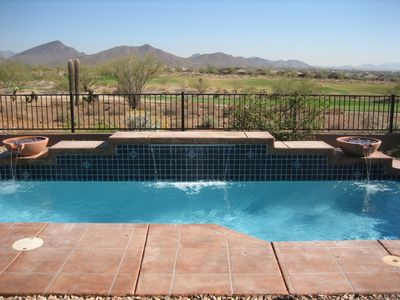 Saltwater pool with mountain and golf course view