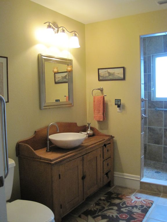 Master Bathroom with large walk-in shower, well equipped with lots of grab bars.