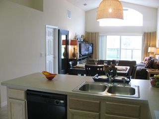 Emerald Island house photo - Spacious Kitchen, Dining, and Family Room Overlooks Private Pool and Landscaping