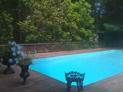 Large 20 x 40 heated pool with 5 magnolia trees.
