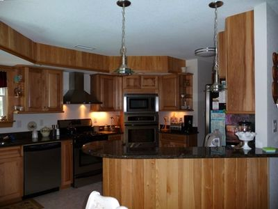 Kitchen with bar sink on breakfast bar, hi-speed fan, 2 large ovens & microwave