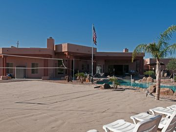 Sand Covered Volleyball Court Just Off of the Pool