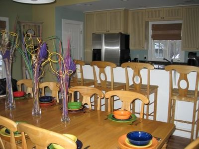 Beautiful colorful kitchen.  Enough chairs to seat the whole gang.