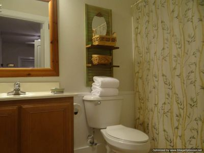 Relax in your master bathroom with full size tub and shower.