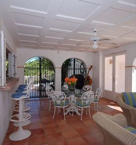 A Sunny breakfast and 'morning room' area open to the pool terrace and waterview