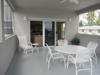 Islamorada house photo - Screened patio for comfortable outside dining