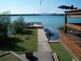 Lake Leelanau cottage rental - View toward dock looking west over private harbor.