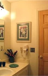 Red Pine Condo: One of two separate vanity rooms linked to the bathroom.
