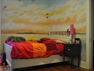 Child's bedroom, queen size bed. Mural painted by Grandma.