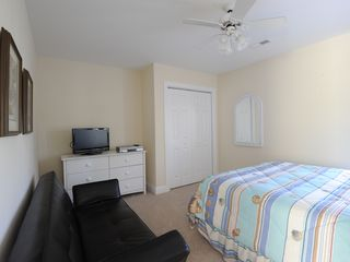 Garden City Beach house photo - Middle bedroom upstairs - queen bed, futon, TV with DVD/VCR