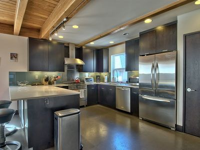 spacious counter area. all modern kitchen with stainless all around.