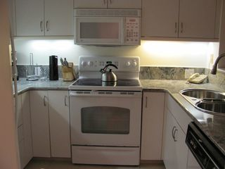 Kingston Plantation condo photo - The kitchen is completely outfitted with everything you will need.