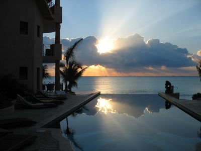 Sunrise over infinity pool and Caribbean