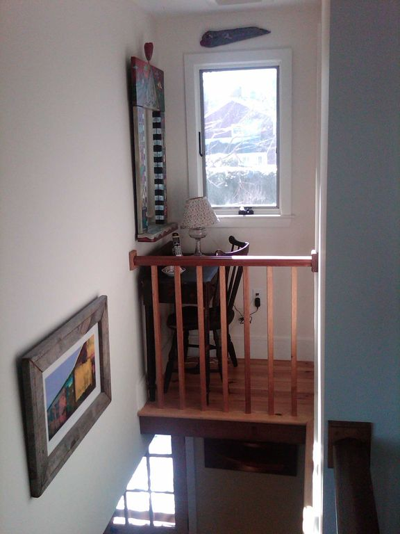Crow's nest above front door/ stairs extends into private study with 32' tv.