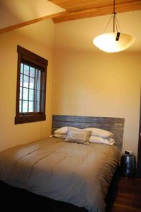 Bigfork house rental - Upstairs guest bedroom with queen size W hotel bed and views of Flathead Lake