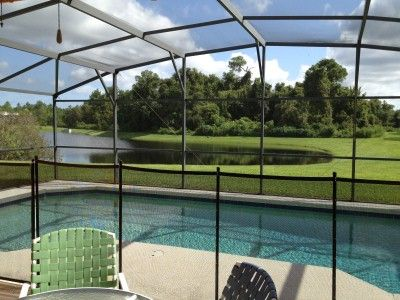 View of the Pool and peaceful pond - home features child safety fence.