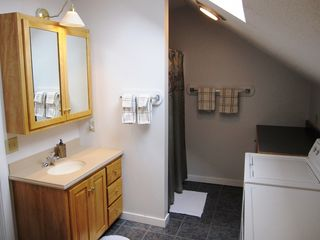 Burke condo photo - Master bathroom with cherry and Corian vanity