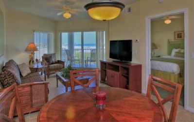 Living/ dining room with balcony overlooking the beach