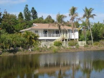 Piling home on secluded lot offers pool and privacy just steps to Gulf beaches.
