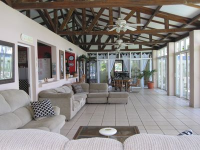 Huge living area overlooking ocean & pool. 2 sectionals & table. 4 ceiling fans.