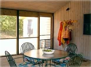 Attached screened in porch adjacent to family room and rear deck.