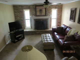 Tavares house photo - Family Rm with fireplace, 40' LED HDTV, DVD, Leather Sofa, ottoman, 2 recliners.