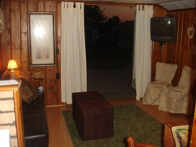 Fold-down sofa in living room, with cable tv. Deck off of the living room.