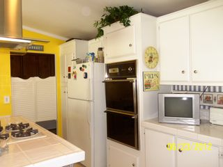 Thousand Palms house photo - Even a TV in kitchen. Swinging doors lead to inside laundry and more storage.