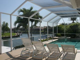 Vacation Homes in Marco Island house photo - Relax poolside with a book.
