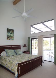 Master bedroom with king bed, vaulted ceilings and access to pool and spa