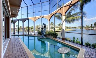 Vacation Homes in Marco Island house photo - Gorgeous Pool with Outstanding Wide Water Views...