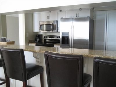 Beautiful Kitchen with new stainless steel appliances and breakfast bar!