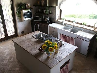 Large fully equipped country kitchen.