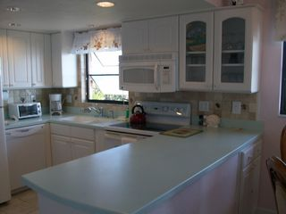 Sanibel Island condo photo - Kitchen with a View. Golfing is nearby.