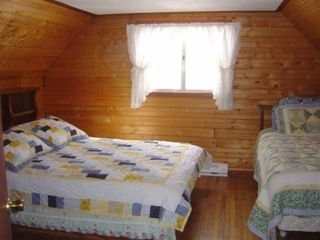 Spacious bedroom with queen and twin bed. - Locust Lake chalet vacation rental photo