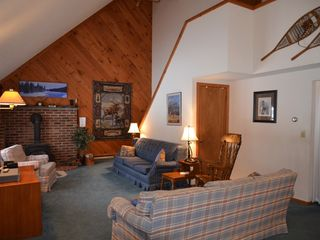 Conway house photo - Living room with falt screen TV and wood burning stove