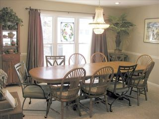 Hot Springs Village house photo - Formal dining room with 10' oak table, crystal chandler