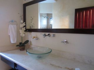 Tamarindo condo photo - Unit 71, bath with glass bowl and marble counter