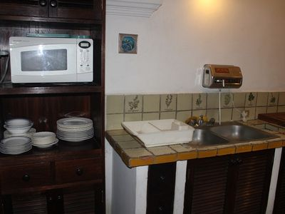 Kitchen equipped with microwave and water filter