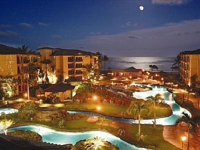 Moonrise over the 2-acre lazy river pool at Waipouli Beach Resort.