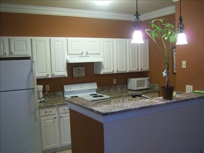 Granite Kitchen With Deep Pantry