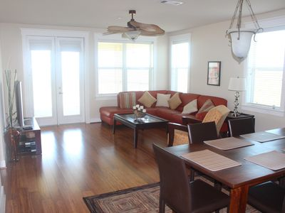 Beautiful new hardwood floors grace the upscale living room